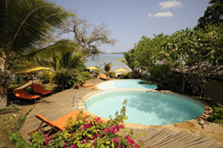 Surrounded by lush gardens leading down onto the beach are the swimming pools at Vanila Beach Hotel Nosy  Be